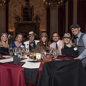 Portland Murder Mystery party guests at the table