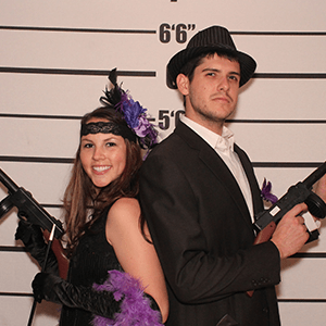 Portland Murder Mystery party guests pose for mugshots